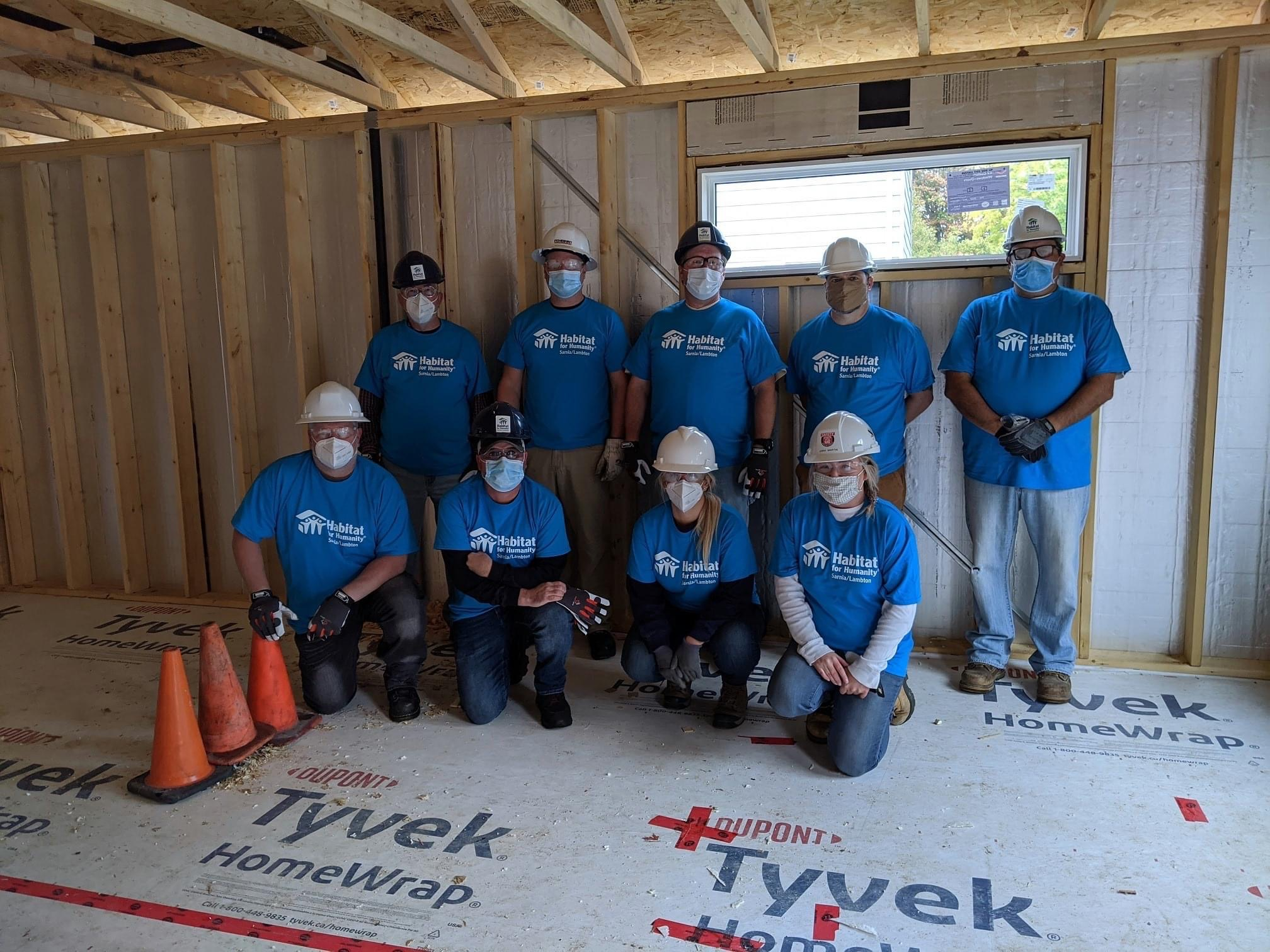 Team in Corunna, ON volunteering at a Habitat for Humanity build