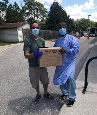 Joel Weed, Technician in Corunna, ON, donating masks to Dr. Daniel of Bluewater Health